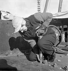 Mrs. A. Mackay, shown here handling a riveting-gun, was employed during World War II in the shipyard at Pictou, Nova Scotia on the Canadian coast. January 1943.