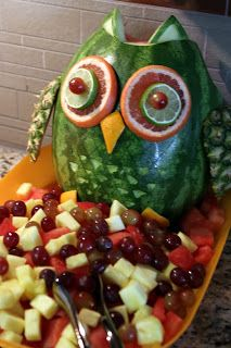 Watermelon and other fruits used to make owl decoration for fruit tray