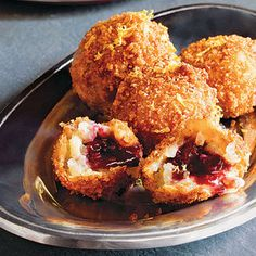 Sweet Fried Arancini Filled With Grape Jam.