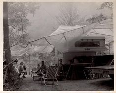 Camping at Big South Fork River, Tennessee circa 1968. I'm the little girl standing by the table. Memories!