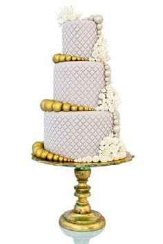 Purple and gold wedding cake.
