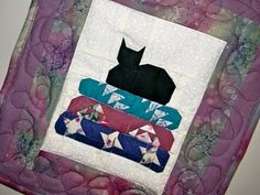 Cat on a quilt stack
