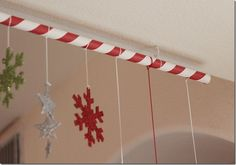 Candy striped hanging rod for Christmas decorations