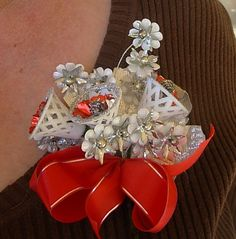 Vintage red and silver Christmas corsage by ultravox on Etsy, $15.00...there was something really special about the fake glossy leaves, plastic bells rimmed with glitter, and outer-spacy trim in colors not normally seen in nature...