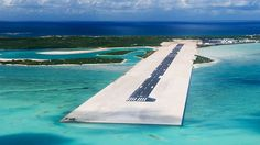 Airports rarely showcase the destination's allure which is why layovers tend to suck, but the one at the Turks and Caicos Islands is a destination in itself. Damn. - #travel #airport #beach #island #paradise #flying