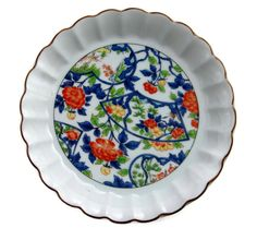 Decorative Lipped Asian Plate Andrea By Sadek. Bright Floral Asian plate. The plate is signed and has the original gold sticker  made in Japan.