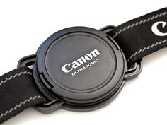 NEVER LOSE A LENS CAP AGAIN: THE LENS CAP STRAP HOLDER. My wife needs this.