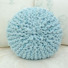 Small round knitted cushion. Knitted all in one piece using short rows. Free pattern. Love this! From craftmehappy.com.