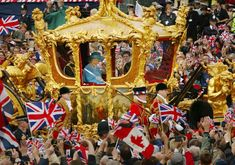 Sion Touhig / Getty Images  Queen Elizabeth and Prince Philip ride in the Golden State Carriage at the head of a parade from Buckingham Palace to St Paul's Cathedral to celebrate the Queen's Golden Jubilee on June 4, 2002.