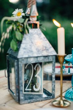 camp inspired table number, photo by Made to Be Mine http://ruffledblog.com/chicago-glamping-wedding-ideas #weddingideas #tablenumber #reception