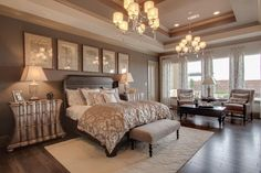 ooo i love the idea of a sitting area in the master bedroom and love the little bench at the end of the bed...i'd choose comfier chairs though :)