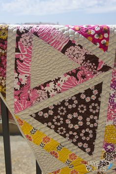 Like the flower echo in the triangle. Jay Bird Quilts