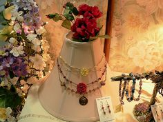 DIY Jewelry craft show display for necklaces using a lamp shade.