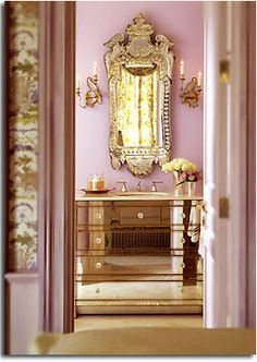 Mirrored bathroom in Mauve. (same mirrored bathroom as below but with different lighting, that gives it a change in color). Kendall Wilkinson Design.