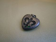 Vintage sterling silver puffy heart charm with fleur de lis