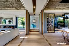 Barefoot Luxury Living in Cape Town - Design Milk - like the warm wood floors with concrete ceilings