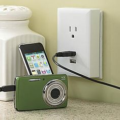 Plugs into an outlet, giving you two USB ports as well as one electrical outlet.