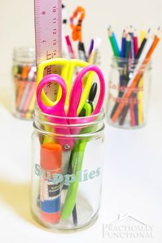 Organize school supplies with mason jars and washi tape!