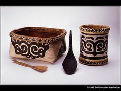 Nanai (round) and Oroch (square) birch baskets from the Khabarovsk region, Siberia. The round basket was made by Nanai artist A.K. Samar in 1991. Khabarovsk Regional Museum, Russia, #VX-312 and #490. 13.5 cm and 20 cm.    Koniag bone spoon collected in 1935 by Ales Hrdlicka on Kodiak Island, Alaska, dated around A.D. 1400, and Tlingit engraved mountain goat horn spoon from the late 1800s. National Museum of Natural History, Smithsonian Institution