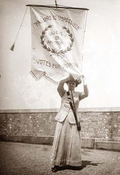 "Suffragette, WWI era Washington DC, holding banner with quote from the late Susan B Anthony. (Sometimes erroneously captioned as ""Susan B Anthony in a suffrage demonstration, but she and Elizabeth Cady Stanton died long before suffrage was won.)"