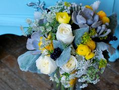 Grey & yellow bridal bouquet with succulents, dusty miller, billy balls