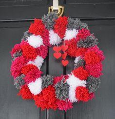 Two It Yourself: DIY Pom Pom Yarn Wreath on a Wire Hanger
