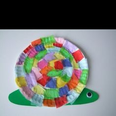 Snail Crafts For Kids.  This bright and colorful Paper Plate Snail craft activity is a ton of fun for preschoolers and kindergarten children to make.  Craft supplies you will need: Paper plate Tissue paper Construction paper/Cardboard  Glue Black marker Googly Eye Scissor Glue  Craft instructions: Have the children draw a spiral on the paper plate (starting at the bottom of the plate) Then, have the children cut tissue paper into square and rectangle pieces. Next, have the children draw and c...