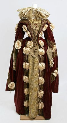 """Velvet, satin, lamé, and lace """"Elizabethan"""" fancy dress costume, French, 1890s. Worn with gold wreath headdress with feather cockade."""