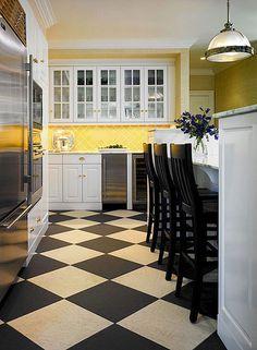 yellow backsplash, white cabinets, black stools, kitchen