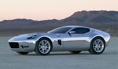 2005 Ford-Shelby GR-1 Concept The Ford GT went out of production in 2006, leaving Ford without a genuine supercar. The GR-1 could have been that car. A 6.4-liter, 605-hp V-10 powers the sinewy silver coupe that was inspired by the 1964 Shelby Daytona coupe. Ford's design chief J. Mays opined that the company could afford to build the GR-1 thanks to its extensive use of Ford GT parts. But no such luck - the car never went into production.