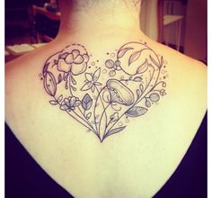 Floral heart tattoo. Breast cancer mastectomy tattoo. [p-ink.org]