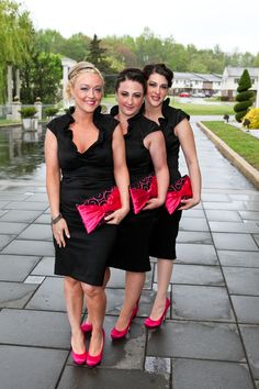 Black and hot pink bridesmaids...my girls.... not necessarily the dress type.. but I like the idea of the black dresses and pink bow clutches and shoes