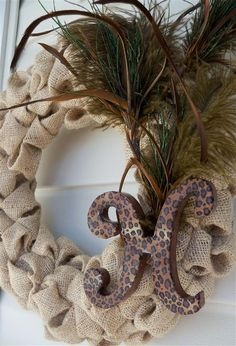 Living Room: Burlap Bubble Wreath with feathers & custom monogram letter....    add peacock feather and turkey feather(s) plus monogrammed initial O with a touch of purple and turquoise...
