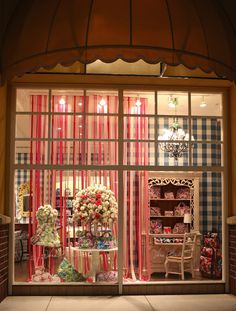 Need a temporary wall, divider or backdrop? Hang streamers ala this Vera Bradley store display.