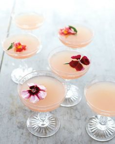Peach colored cocktails with fresh flower garnish - lovely!