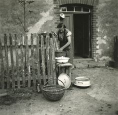 Woman washing.  Found photo.  Germany