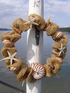 SEASHELL WREATH, burlap, beach decor, nautilus shell, nautical wreath, starfish. via Etsy.