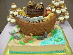 """Take a look at this Noah's Ark baby shower cake! Can you believe the animals are made out of gumpaste? Click """"Repin"""" if you are as impressed as we are! #cakedecorating #babyshower"""
