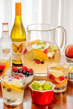 Enjoy the warm summer breeze with an easy Smirnoff Ice Original Sangria! Just mix 2 cups Smirnoff Ice Original and 2 cups Butterfly Kiss Chardonnay in a large pitcher. Add fresh oranges, blueberries, lemon wheels, lime wheels, raspberries, apples, and peaches to soak to make 6 servings.