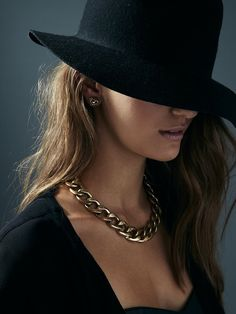 Chain necklaces and a great sleek hat.