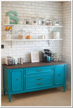 Teal painted dresser in kitchen, painted brick, open shelving