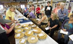 Hopeful entrants watch as pies, pastries, jams and jellies and other homemade goodies are tested during Colorado State Fair pantry judging Tuesday in the Creative Arts Building. Queen or King of the Kitchen, the entrant with the best overall score in a variety of categories, will be announced Friday afternoon during the opening day of the Fair. (Chieftain photo by Chris McLean, 8/21/2012)