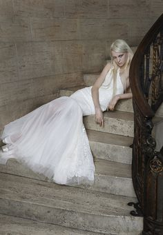 Look 9. Ivory one-shoulder mermaid gown with hand appliqué lace and floral beading accented by a soft tulle skirt.