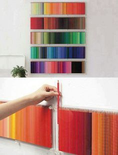 pencil crayons organized on a wall