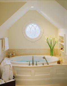 master bath idea? freestanding tub, but love the little window and different ceiling? perhaps a step or two up into an alcove, so it's separate from rest of bath?
