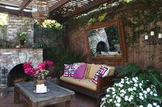 Outdoor room with fireplace, mirror