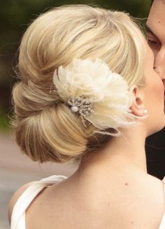 Bridesmaid updo? I love a little volume poof at the top but simple for the rest with a hint of accent of the feathered hair clip.