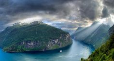 Geirangerfjord with cruise ship and The Seven Sisters waterfall on far right, Geiranger, Møre og Romsdal, Norway