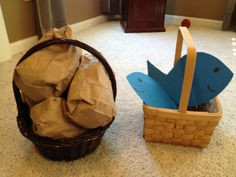 """Hot potato type game played with two baskets: one with """"loaves of bread"""" (stuffed paper lunch bags) the other with paper fish. We had a large group so we used both baskets going in opposite directions. Added difficulty with rule that they had to keep fish & loaves in the baskets."""