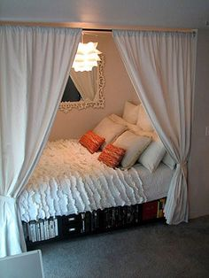 Put the bed in a closet so the whole room is open. Love the book space underneath too.